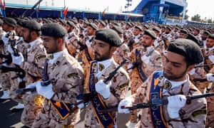 Members of the Revolutionary Guards take part in the parade before the assailants opened fire.