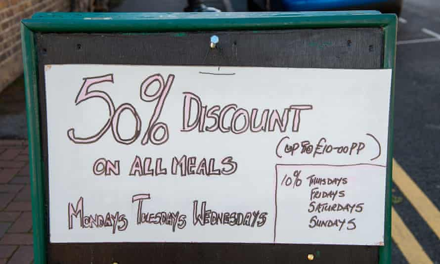 hand written sign outside restaurant offering its own discounts with not a stray apostrophe in sight