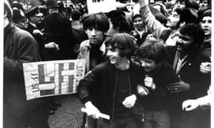 Anti-Vietnam war demonstrators run past Downing Street in 1968.