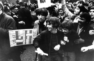 Anti-Vietnam war demonstrators run past Downing Street in London on 27 October 1968