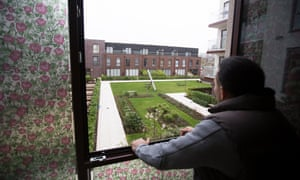 Salvatora Rea looks out at the communal play area and garden his children are not allowed to use.
