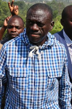 Ugandan opposition leader Kizza Besigye was put under house arrest after the election result was declared.
