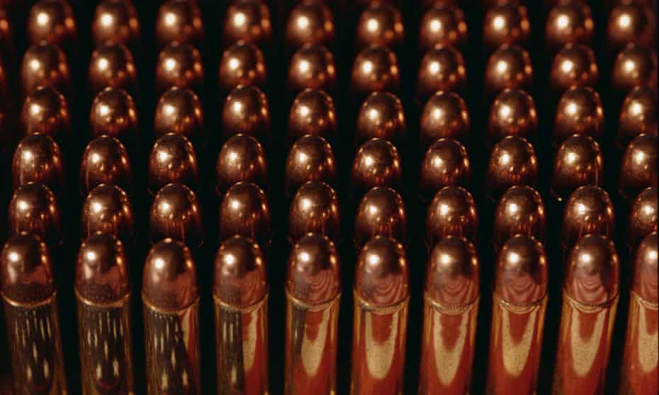 They look a little like small golden lipsticks ... .38 Special bullets off the production line. Photograph: Philip James Corwin/Getty Images