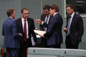 Members of the Parliamentary joint committee on Intelligence and Security on the floor of the House of Representatives chamber, Chair Andrew Hastie, Deputy Chair Anthony Byrne, Dr Mike Kelly and a Julian Leeser talk to Attorney-General Christian Porter during voting procedures yesterday