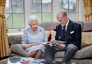 Queen Elizabeth II and Prince Philip, Duke of Edinburgh look at their homemade wedding anniversary card, given to them by their great grandchildren Prince George, Princess Charlotte and Prince Louis, at Windsor Castle ahead of their 73rd wedding anniversary in November 2020