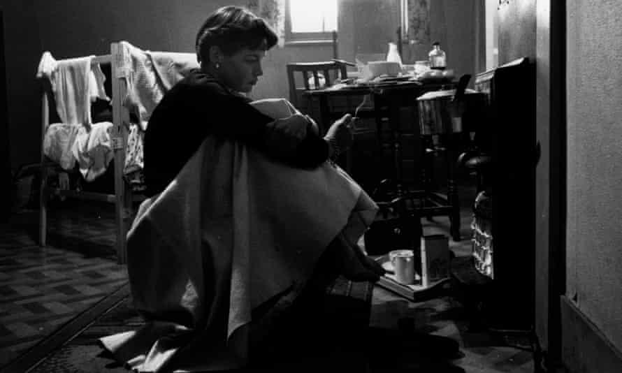 Journalist and writer Katharine Whitehorn in her bedsit circa 1960.