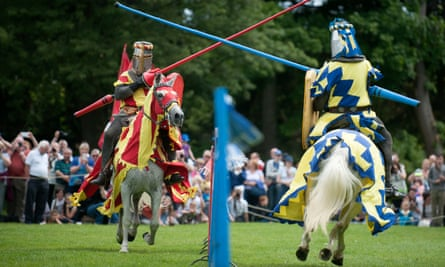 Knights on horseback taking part in a medieval jousting tournament
