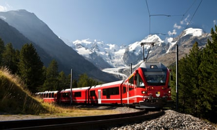 red Swiss train with mountains and glacier in the background