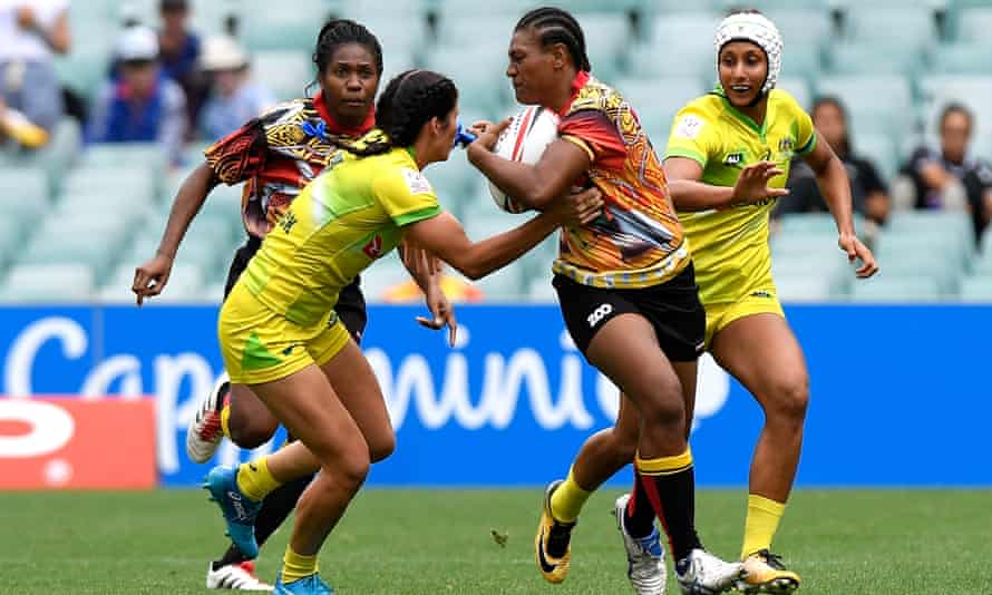 Debbie Kaore of Papua New Guinea takes on the defence in the match against Australia during day one of the 2018 Sydney Sevens at Allianz Stadium.