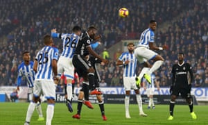 Christopher Schindler (26) and Timothy Fosu-Mensah of Fulham rise together for a Huddersfield corner that led to the home side's goal.