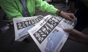 An extra edition of a newspaper reporting about North Korea's missile launch is distributed at Shimbashi station in Tokyo on Friday.