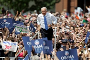 Senator Joe Biden jogs out to meet Senator Barack Obama during a campaign event for the 2008 presidential election on 23 August 2008 in Springfield, Illinois.