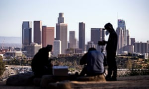 Unemployed cameramen fly drones and take pictures of Downtown from Elysian Park amid the coronavirus pandemic in Los Angeles, California, this week.