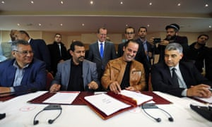 The UN envoy for Libya, Martin Kobler, centre, standing, blue tie, looks on as representatives of Libyan municipalities sign an agreement supporting Libya's new national government in Tunis earlier this month.