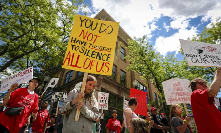 Demonstrators protest against the Keystone XL pipeline in Rapid City, South Dakota, on 12 June 2019.