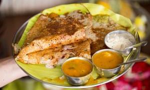 Onion rava dosa served in a style reminiscent of restaurants in southern India.