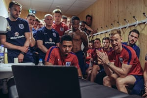 England players crowd round after a training session in Paris in 2017 to watch England under-20s beat Venezuela.