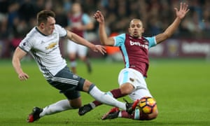 West Ham's Sofiane Feghouli challenges Phil Jones