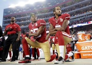 San Francisco 49ers players Eric Reid and Colin Kaepernick kneel during the national anthem before an NFL football game in Santa Clara, California, in 2016.