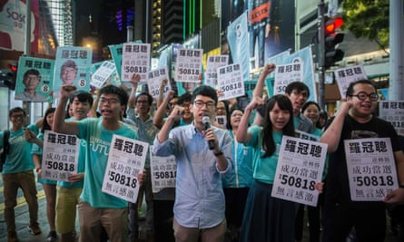 Nathan Law with Joshua Wong and supporters in Causeway Bay following Law's LegCo win