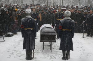 A guard of honour stands next to the coffin holding the body of Oleg Peshkov, the Russian pilot of the downed SU-24 jet, during a funeral ceremony in Lipetsk, Russia