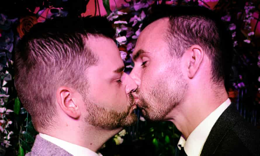 Shane Sweeney and Eoin McCabe kiss after their mock wedding in a Belfast cabaret club.