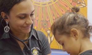 Katarina Keeler examining a child with a stethoscope. IndigenousX