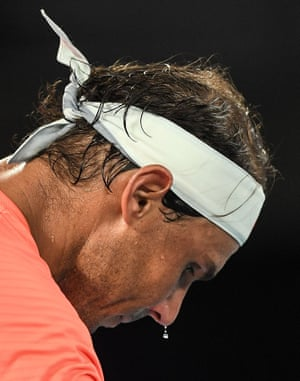 Sweat drips off the nose of Rafael Nadal.