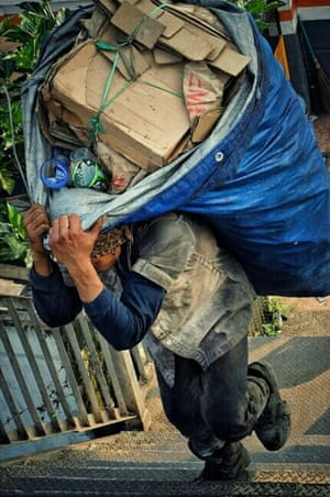 Struggling to carry a heavy sackPhotograph: dmz mzd/GuardianWitness