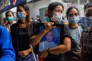 Korat, Thailand. Mourners at Terminal 21 shopping centre