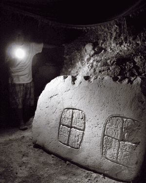 The third hieroglyphic panel discovered at the Mayan ruins in Xunantunich, in western Belize, with Awe holding a flashlight.