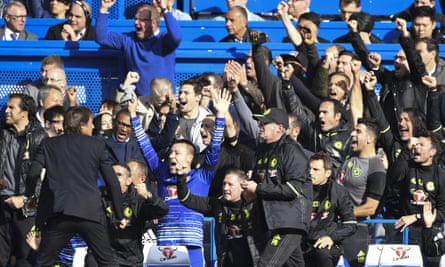 John Terry celebrates with Chelsea's backroom staff as Chelsea score a third goal against Leicester City.