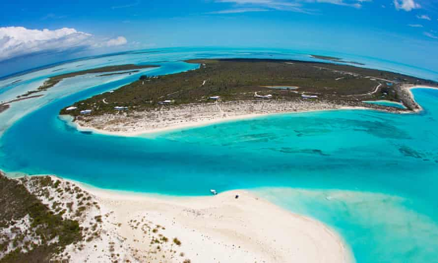 An aerial view of channels cut through the sand by water in the Turks and Caicos Islands.