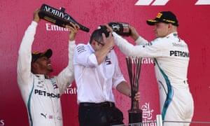 Lewis Hamilton (left) celebrates winning in Barcelona.