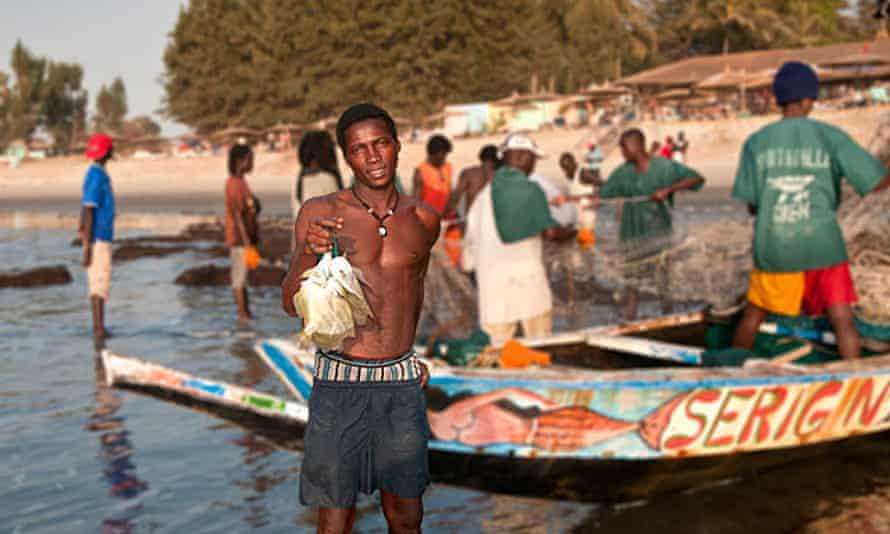 A fisherman with a catch of angelfish, near Serrekunda in the Gambia
