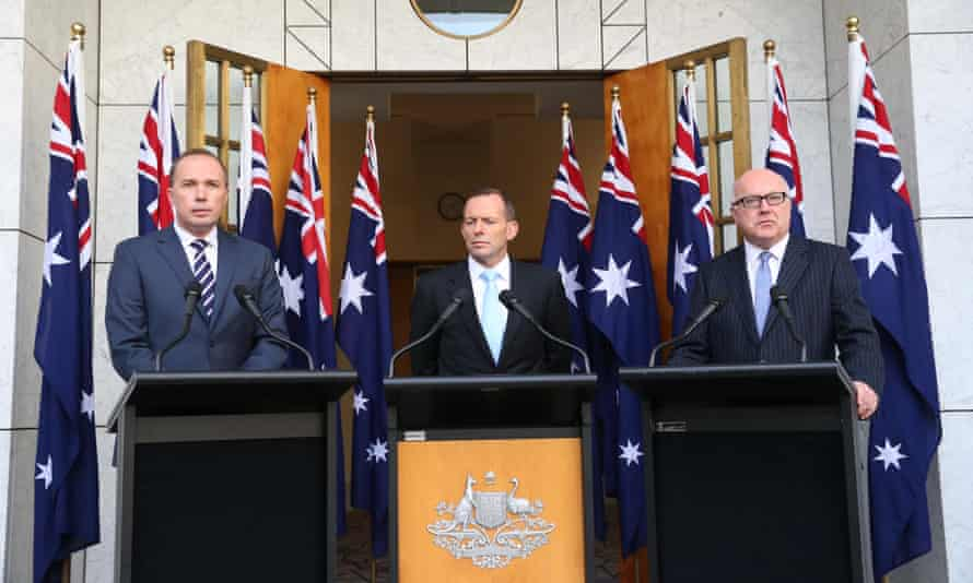 Prime Minister Tony Abbott, Immigration minister Peter Dutton and attorney-general George Brandis at a press conference in parliament house, Canberra this afternoon, Tuesday 23rd June 2015. Photograph by Mike Bowers for Guardian Australia #politicslive
