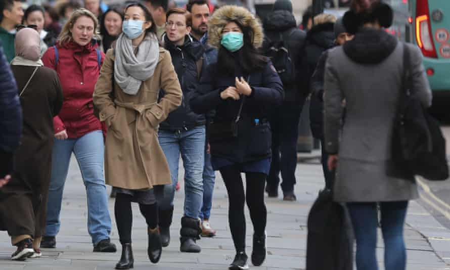 People wearing medical masks in central London