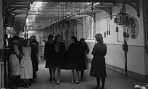 A prison officer and group of inmates at Holloway in 1947. Built in 1852, HM Prison Holloway became a female-only prison in 1903.
