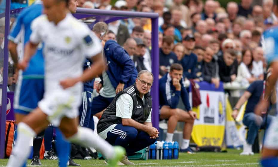 Marcelo Bielsa crouches to watch Leeds's friendly against Real Betis.