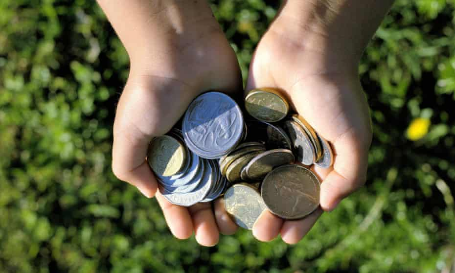 Australian coins in a child's hands