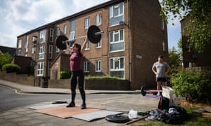The CrossFit enthusiast Elena Demou and her personal trainer, James Luong, work out by the side of the road in London