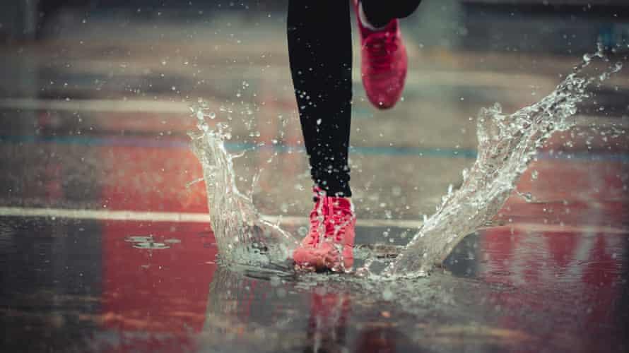 Runner on a wet pavement