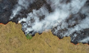 Billows of smoke rise over a deforested plot of the Amazon jungle in Rondonia State, Brazil, August 24, 2019.