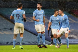 Ilkay Gundogan of celebrates with Phil Foden (right) after scoring Manchester City's second goal.