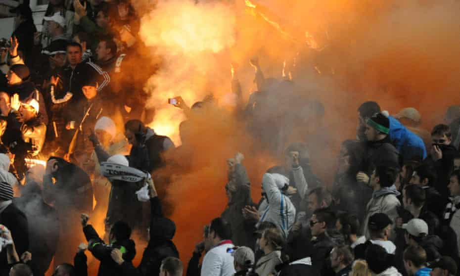 Russian soccer fans light flares during a fourth round Russia Cup match between Dinamo Moscow and Torpedo Moscow, 2012.