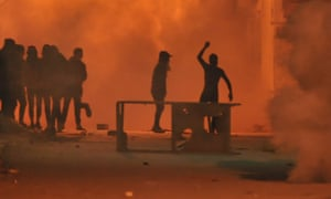 Protesters throw stones at security forces in the Djebel Lahmar district of Tunis