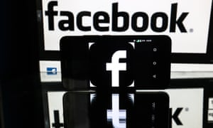 Facebook social networkST PETERSBURG, RUSSIA - NOVEMBER 16, 2016: A smartphone schowing a facebook logo, on a reflective surface in front of a computer screen showing a Facebook sign. Sergei Konkov/TASS (Photo by Sergei Konkov\TASS via Getty Images)