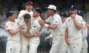 Joe Denly (third left) is congratulated by teammates after dismissing Dean Elgar during England's victory in Cape Town.