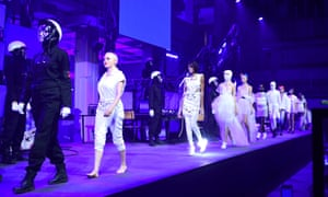 Rose McGowan leads models on the catwalk during the Nicholas Kirkwood London fashion week show.
