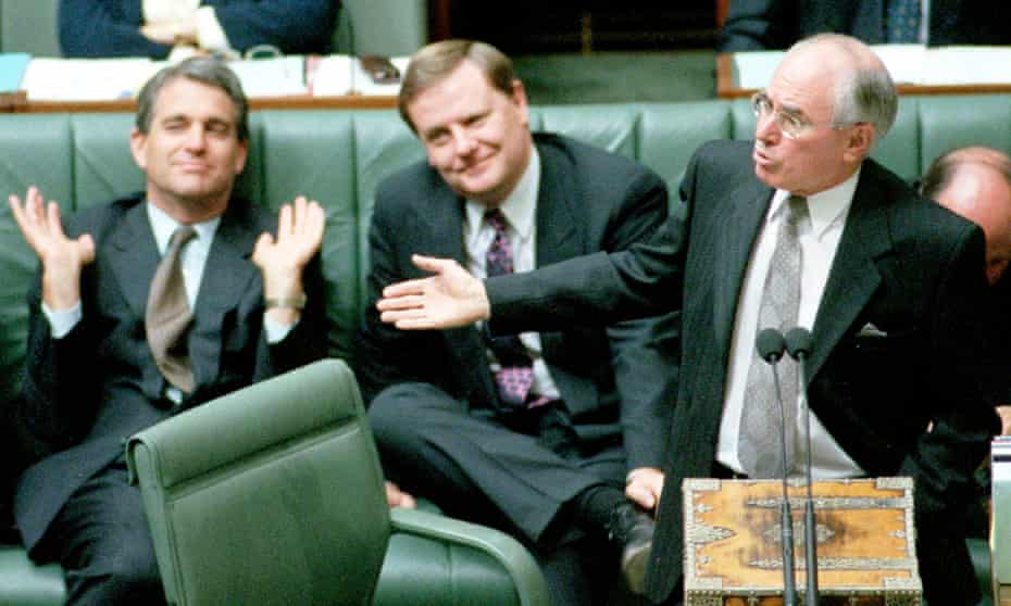 John Howard addresses parliament, watched on by Peter Costello and John Anderson.